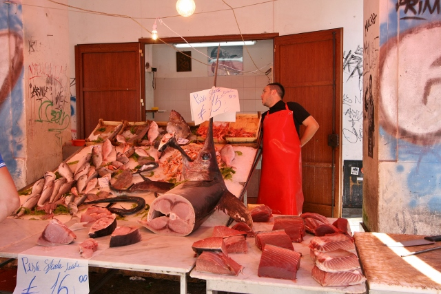 Fish monger, note the remnants of the swordfish