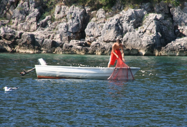 Bigovo fisherman collecting his catch next morning