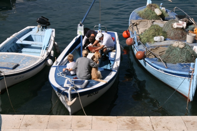 All a boy needs, a boat, Mom and his dog.  Early morning scene on Bol Harbour