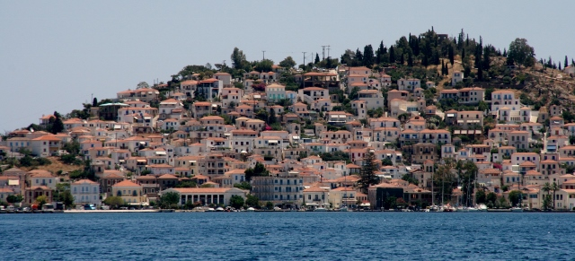 Poros, shimmering  in the distance.